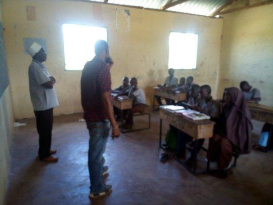 Mr. Eddy Adison addressing Bahati Primary students