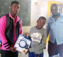 Bakari receiving his Solar Lantern