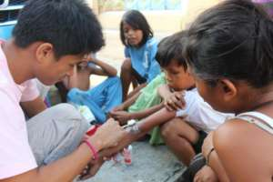 The youth teach street kids to treat wounds