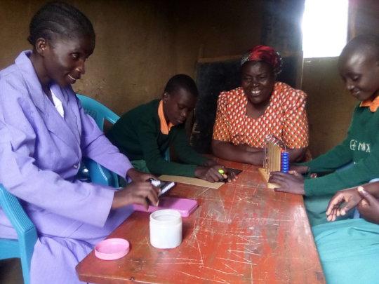 Volunteer  teacher giving lesson