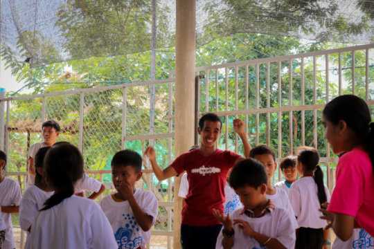 Sok leading a dance workshop at a local schools
