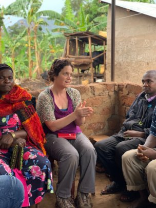 Programs Director Brandy Lellou talks with farmers