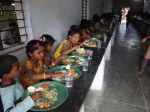 Children with water during mid-day meal