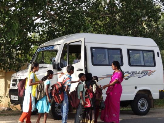 Children picking up from their home through van