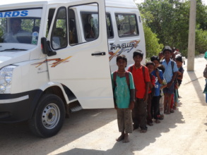 Children waiting in queue to get into the Vehicle