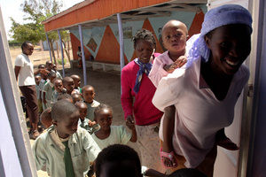 Mothers and children anxiously wait for vaccinations