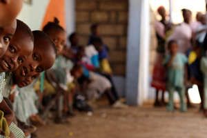 Children wait in line at Mama Hope Health Clinic