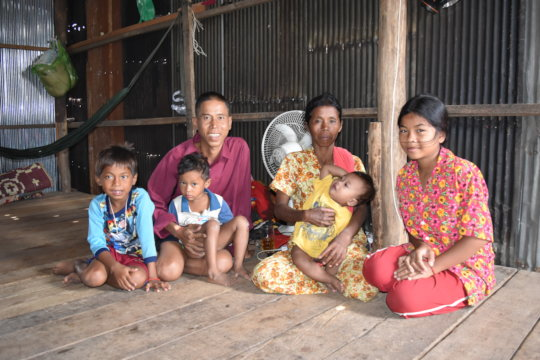 Koerng and his family in their one-room home