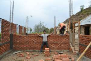 Surya in the field during construction