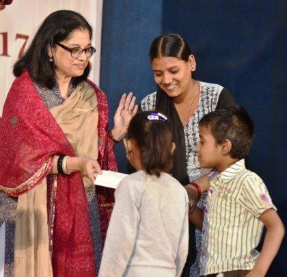 Mrs Sukanya Bharatram presenting scholarships