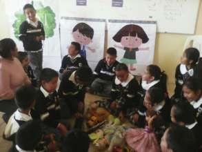 Teacher replicating the program in class
