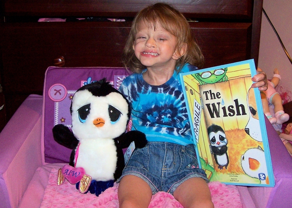 """A very happy medically fragile Girl with our book & toy """" Cory"""""""