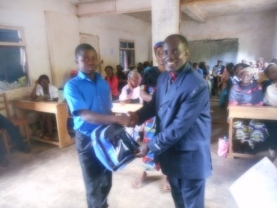 Director handing over a bag to a student