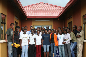 Village youth in front of their new homes