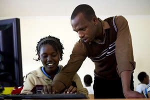 A student learns how to use a computer