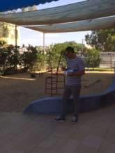 Taking mesurements of the playground for the plans