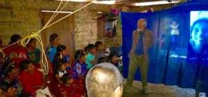 Chel families see photos of scholars at Ak Tenamit