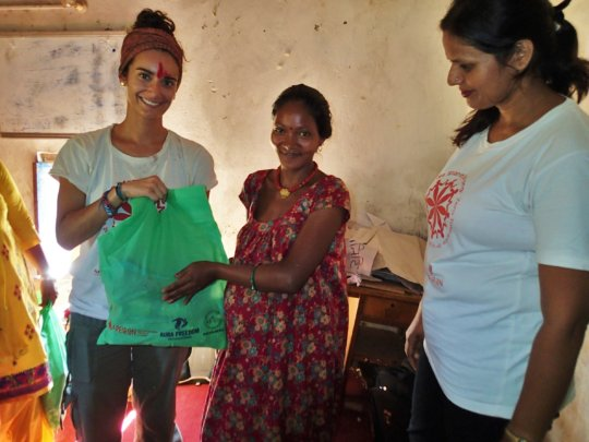 A pregnant woman receives an Outreach Mommy Kit.