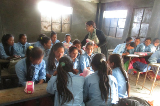 Outreach participants receive sanitary pads.