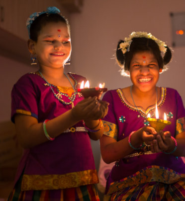 Lighting the Diwali lamps