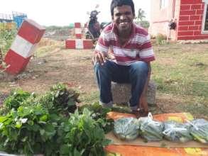 Basuvaraj selling fresh greens