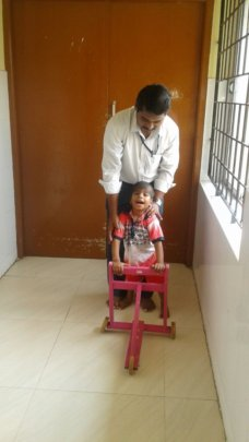 Sudharshan with his physiotherapist