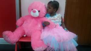 Kissing the Teddy she was gifted on her birthday