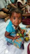 Sharing fruits with Gypsy children