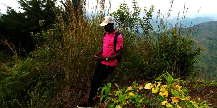 Survey team member, measuring a farm with GPS.