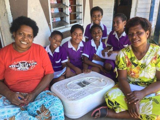 Seni and the incubator + curious school girls