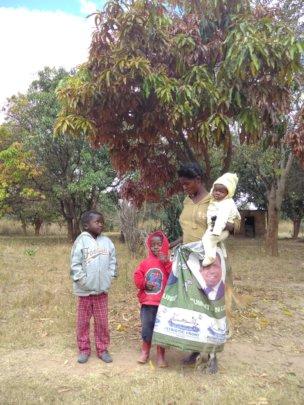 Thandi with her children on their farm