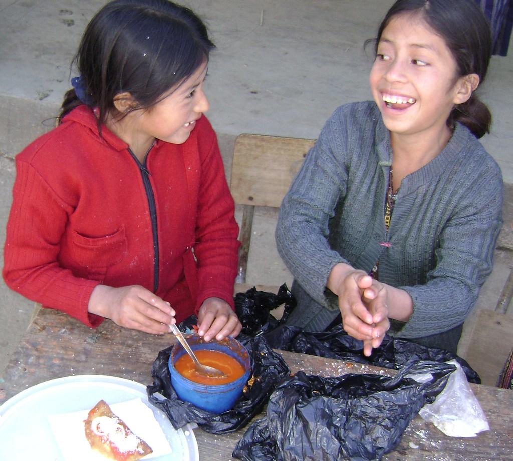 Enjoying their school meals