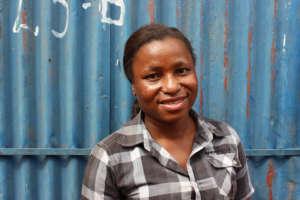 Benvinda in front of her store in Maputo