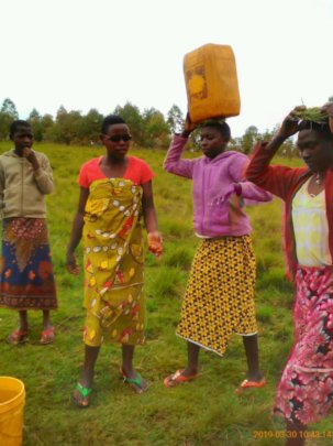 Women carry drinking water from 1 to 2 km away