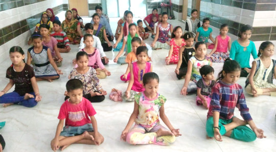 Girls are doing yoga during awareness session