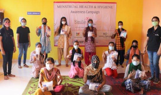 Girls with hygiene kits