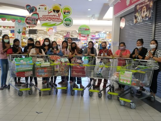 The women shopping for supplies for their families