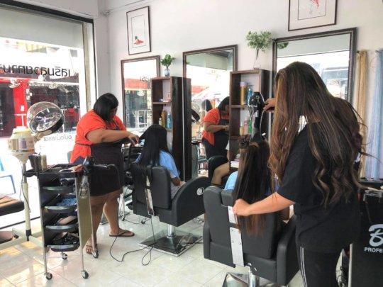 Women receiving free hair treatment