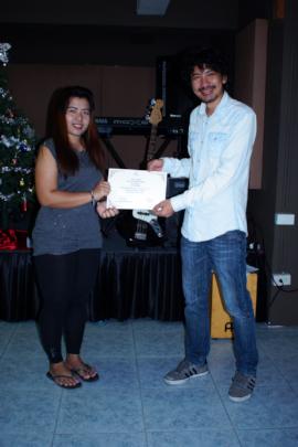Women receiving her Cooking Certificate