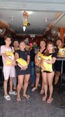 Bar Girls happy about receiving our food donations