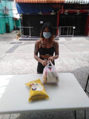 Women receiving food bags