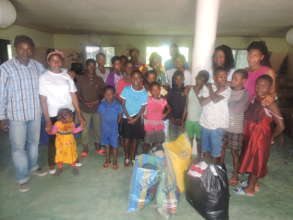 Project team donate food item to ophange children