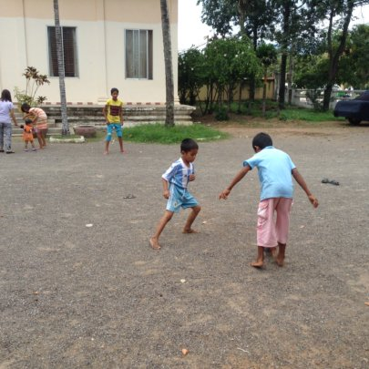 Playing football with his friend Phi