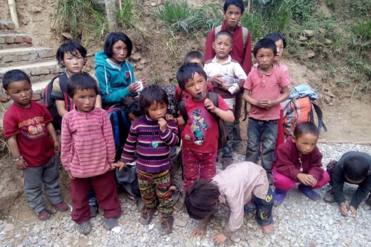Young children in a transit home following quake