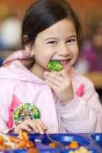 Girl Eating Broccoli