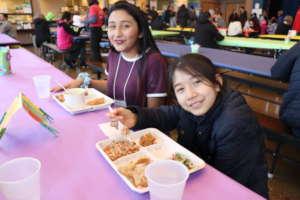 Two students enjoy Lummi Island Wild Salmon Cakes