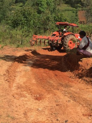 The tractor again making repairs after rainy seaso