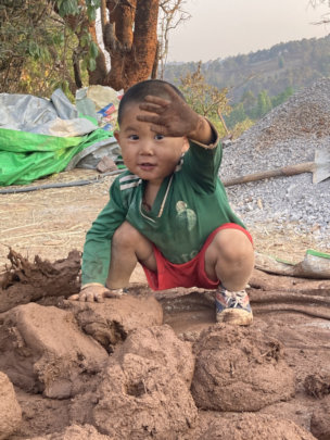 Playing in the mud-building our house!