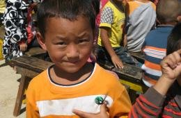 Child with badge
