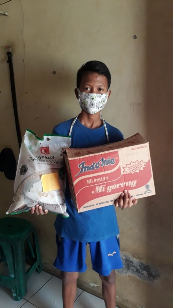 Puja received foods' material for his family